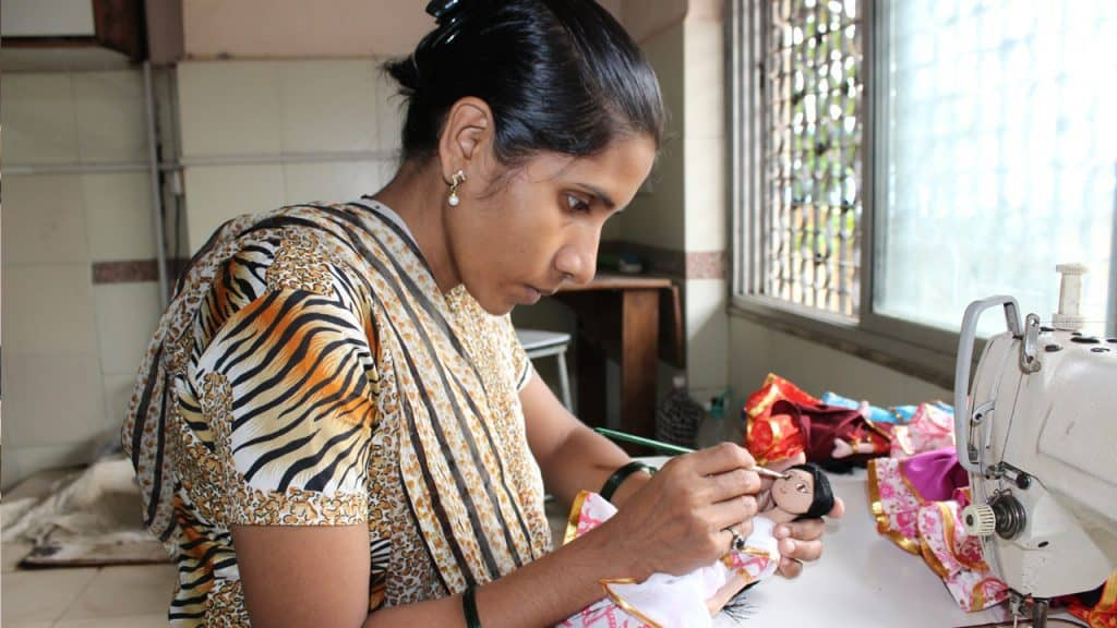 Woman making a doll - Creative Handicrafts Coop