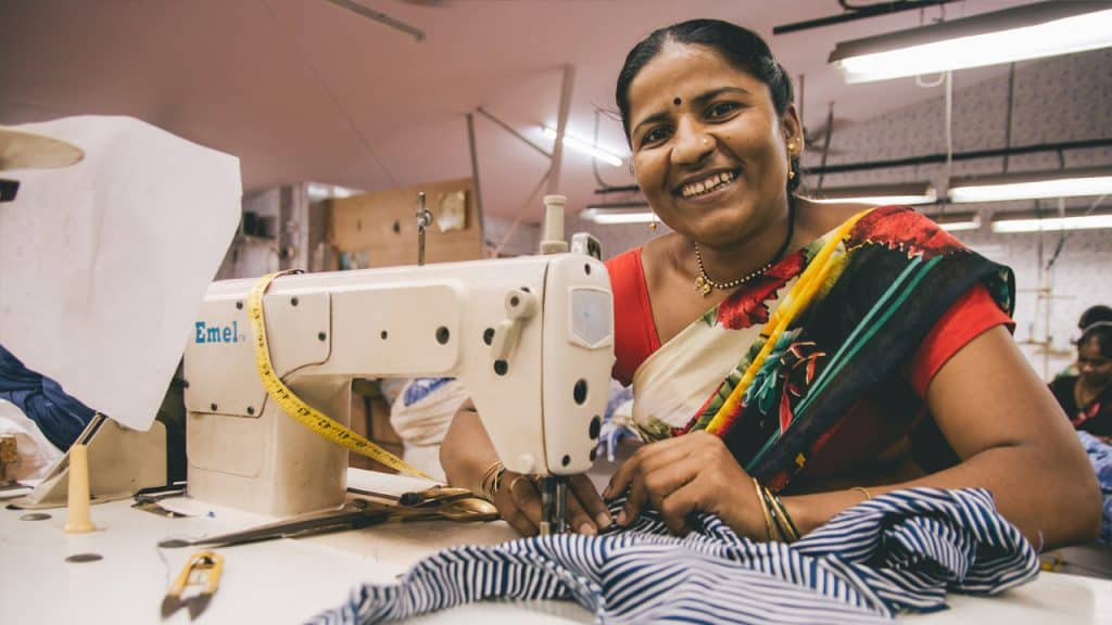 Woman sewing - Creative Handicrafts Coop