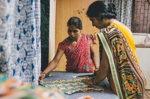 Examining fabric during Creative Handicrafts training