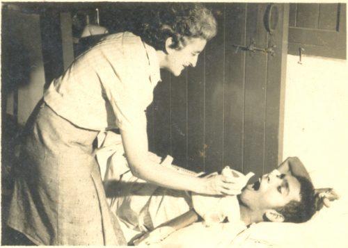 Sister Isabel nursing a patient