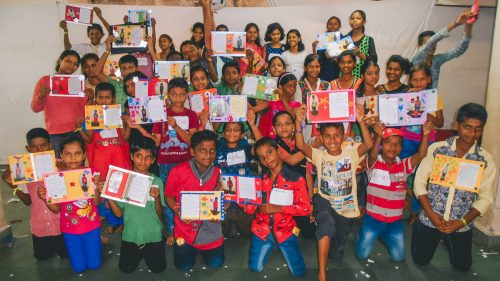 Sponsored children showing of the Christmas cards they made