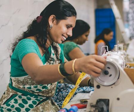 Woman sewing fair trade garments at Creative Handicrafts